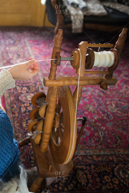 Girl spinning wool into string