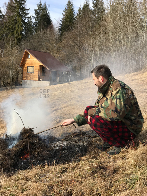a man is making fire in the nature