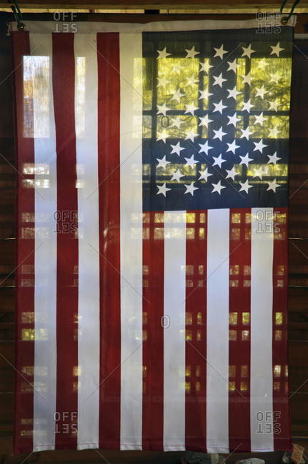View of translucent American flag on back porch