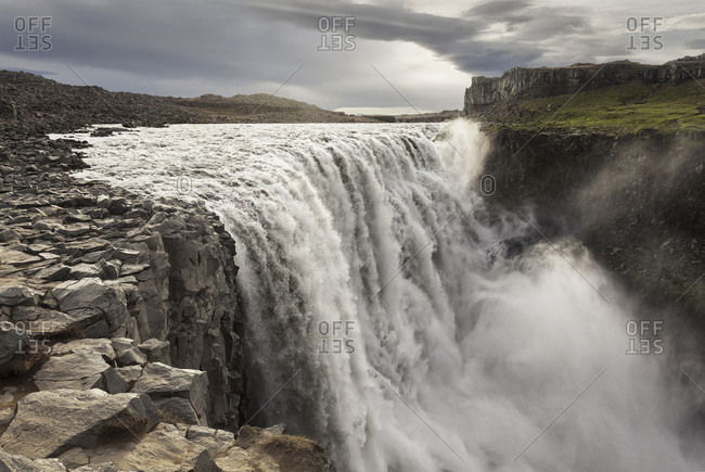 Rushing water of the Dettifoss Falls on a cloudy day in Vatnajokull National Park in Northeast Iceland