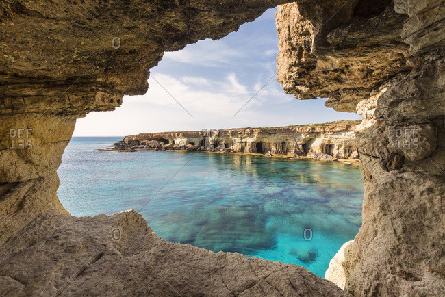 Sea Caves along Rocky Coast by Mediterranean Sea at Sunset, Cape Greco, National Forest Park, Ayia Napa, Cyprus