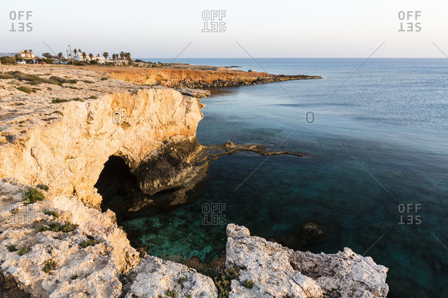 Sea Caves along Rocky Coastline by Mediterranean Sea at Sunset, Ayia Napa, Cyprus