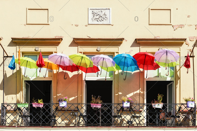 Poland- Warsaw- colorful umbrellas on a balcony