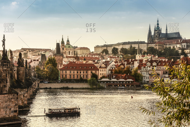 Prague, Czech Republic - September 15, 2016: View to castle and Charles Bridge with Vltava in the foreground