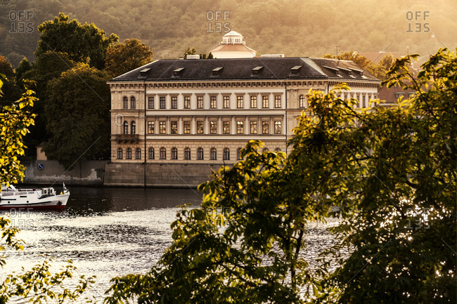 Czech Republic- Prague- view to Liechtenstein Palace with Vltava in the foreground