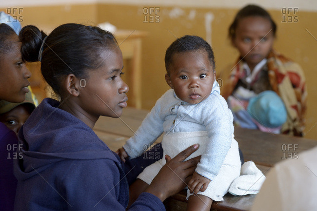 Madagascar- Fianarantsoa- Young mother with baby boy attending mother and child group