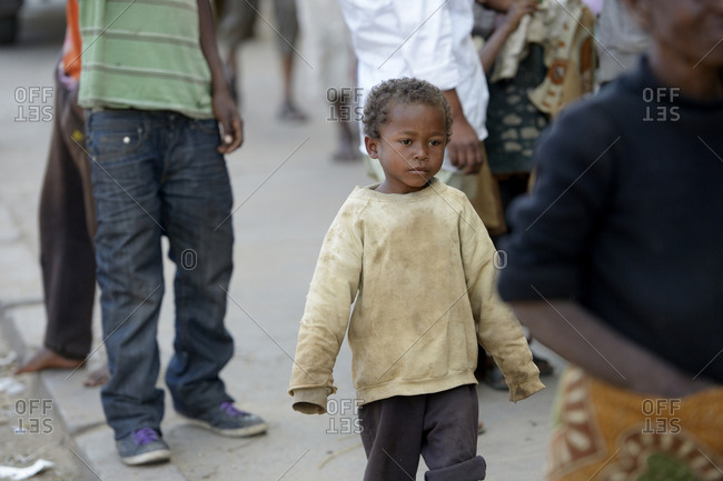 Madagascar- Fianarantsoa- Homeless boy walking in the street