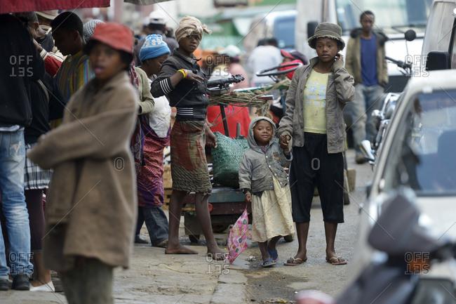 Madagascar- Fianarantsoa- Homeless mother walking in the street