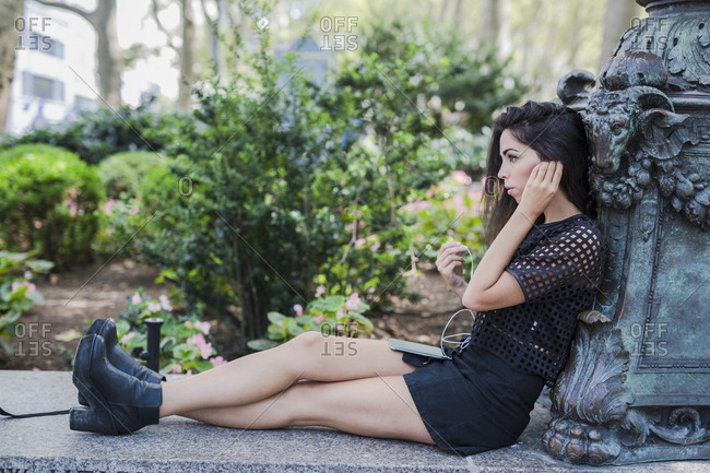 Brunette young woman listening music with ear buds