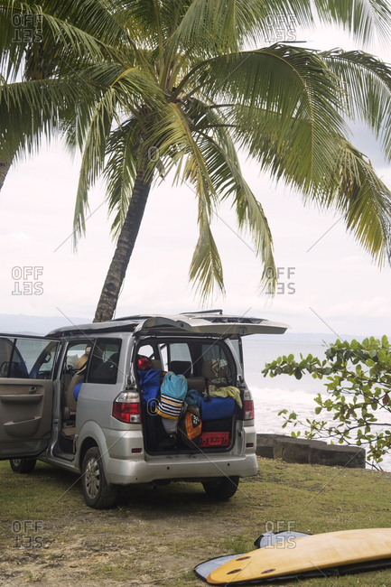 Indonesia- Java- car and surfboard at the coast