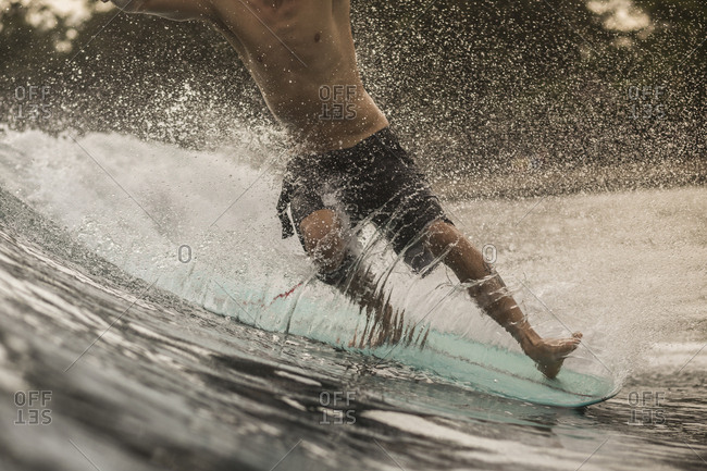 Indonesia- Java- close-up of man surfing