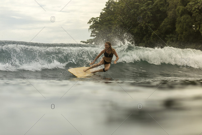 Indonesia- Java- happy woman surfing