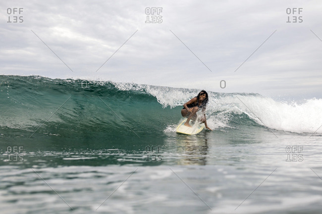 Indonesia- Java- woman surfing