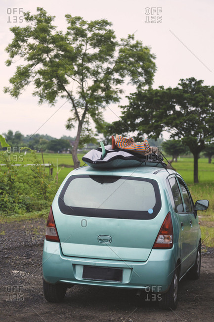 Indonesia- Java- car with surfboards on the roof