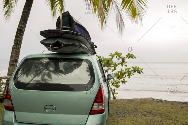 Indonesia- Java- car with surfboards on the roof at the coast