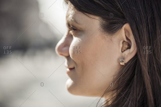 Young woman with hearing aid- close-up