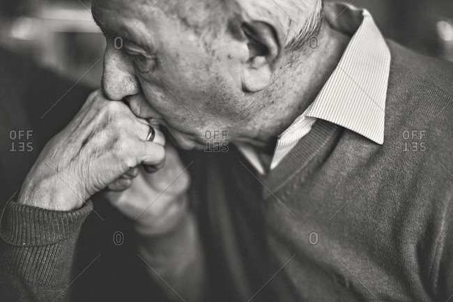 Senior kisses the hand of his wife