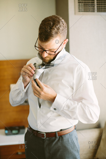 Groom working on his tie