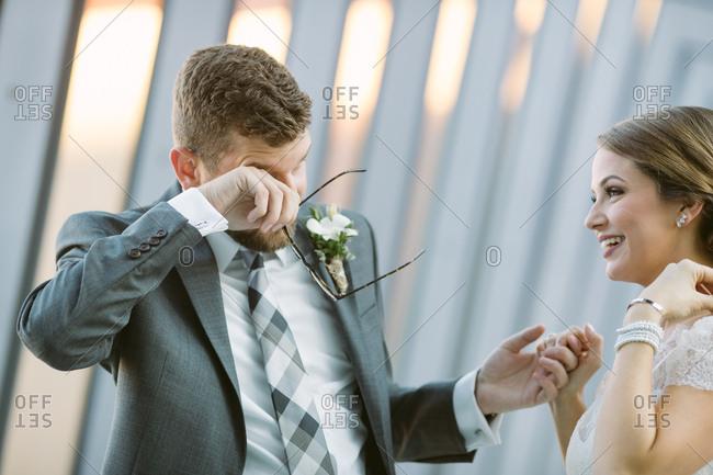 Bride with emotional groom