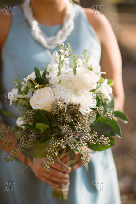 A bridesmaid with white flowers