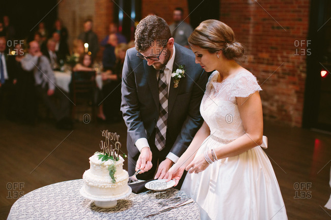 Bride and groom during their cake cutting