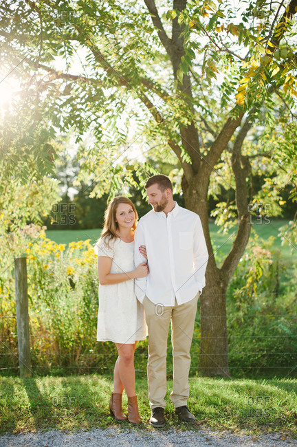 Couple in white clothes in rural setting
