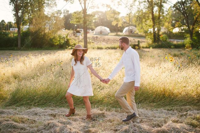 Loving couple by sunflower garden