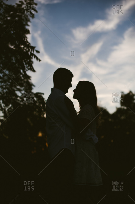 Couple in a rural silhouette embrace