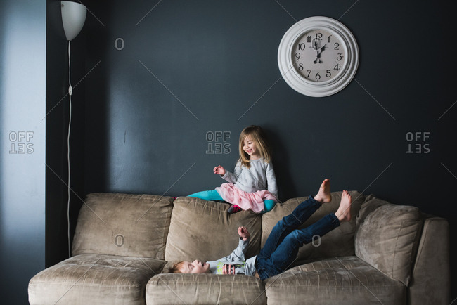 Young children playing on couch
