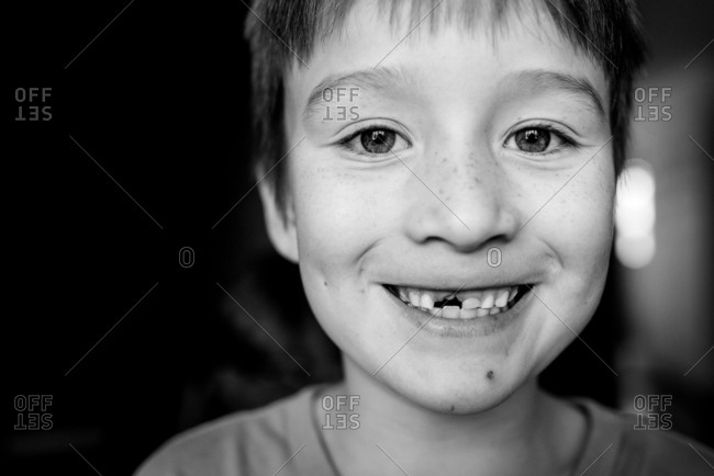 Portrait of young boy with missing front tooth