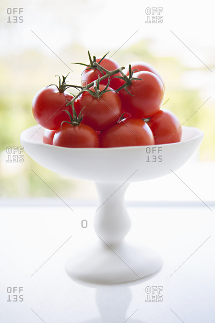 Cherry tomatoes in white footed bowl
