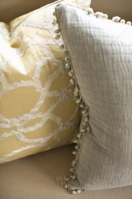 Two upholstered pillows