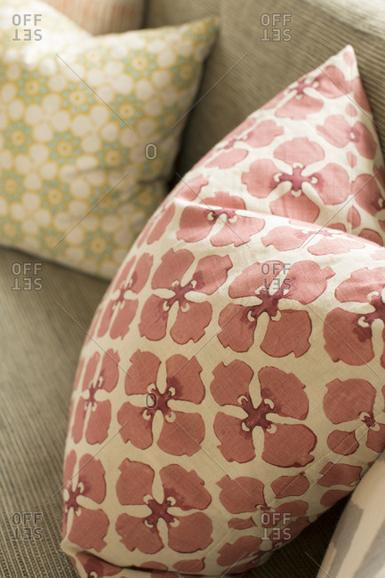 Red flowered pillow on chair
