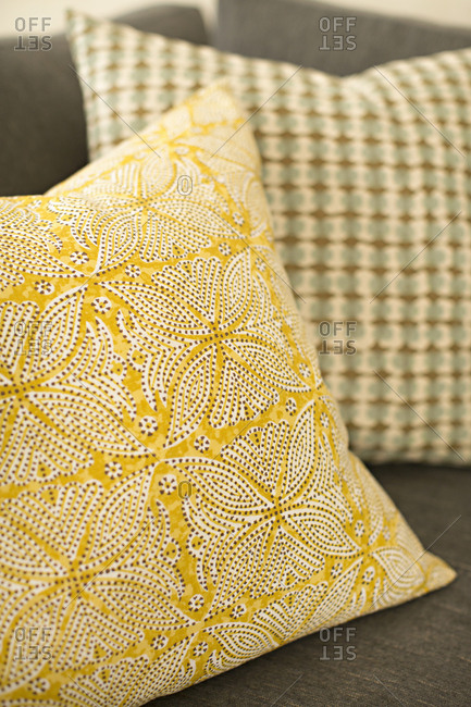 Yellow patterned pillow on chair