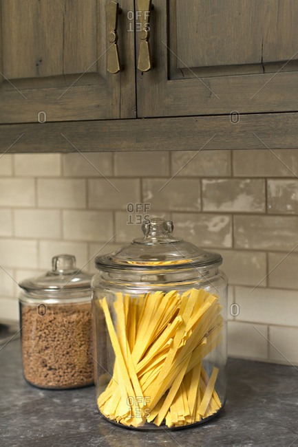 Dried noodles in glass canister on counter