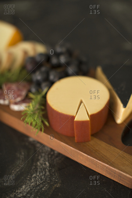 Cheese and charcuterie on cutting board