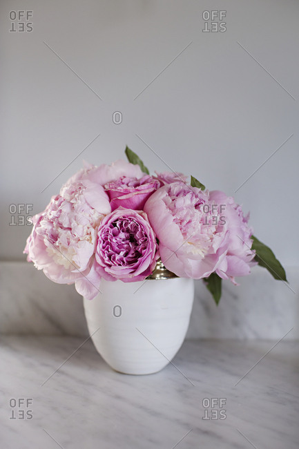 Arrangement of pink peonies in vase