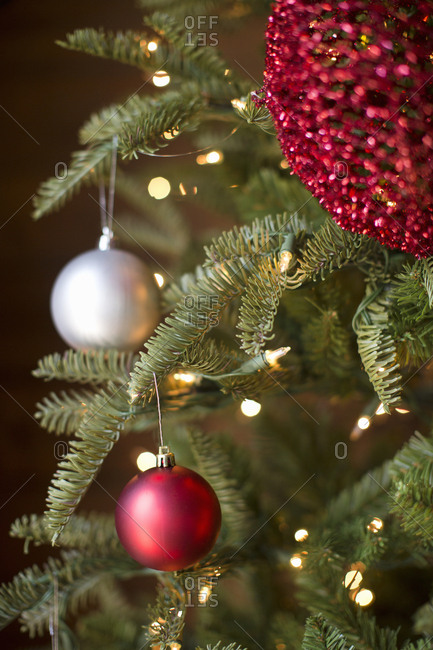Gold and red Christmas decorations on tree