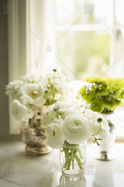 White and green flowers arranged in vases