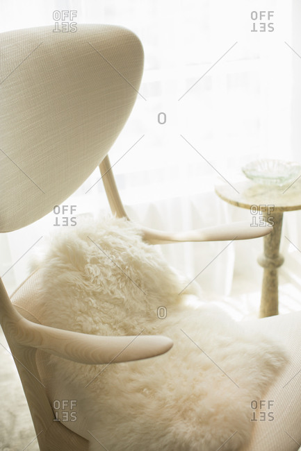 Chair with white furry pillow