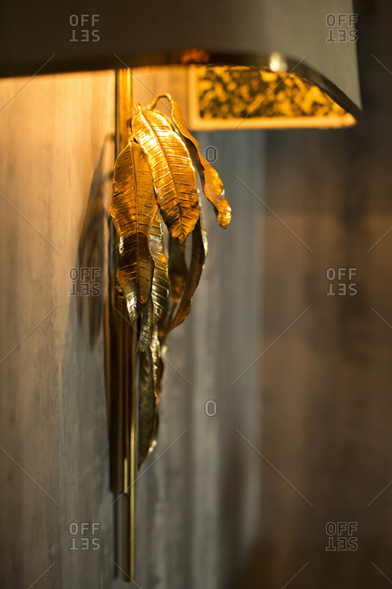 Designer light fixture with gold leaves
