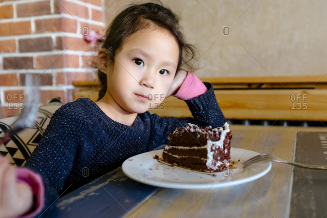 Girl with cake in restaurant