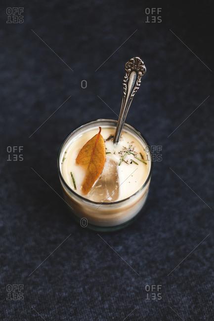 A leaf in a creamy drink