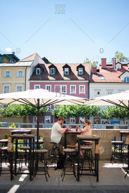 Ljubljana, Slovenia - July 22, 2015: Couple at a street side restaurant in Ljubljana, Slovenia