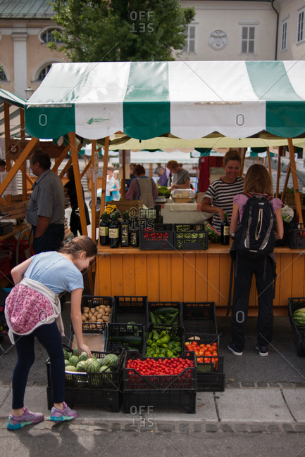 Ljubljana, Slovenia - July 22, 2015: Shoppers at a shopping at a farmer's market in Slovenia