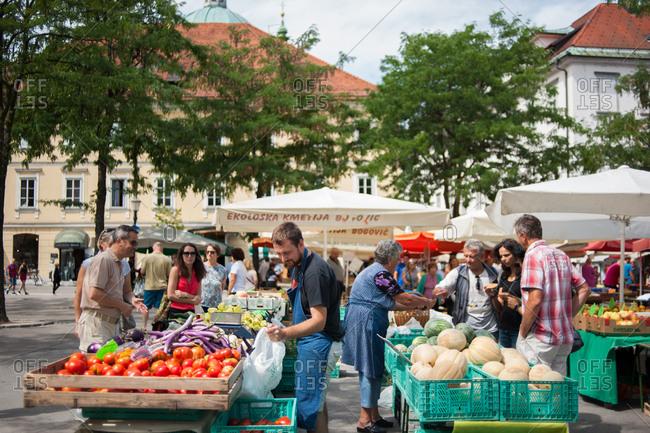 Ljubljana, Slovenia - July 22, 2015: People shopping at a farmer's market in Ljubljana, Slovenia