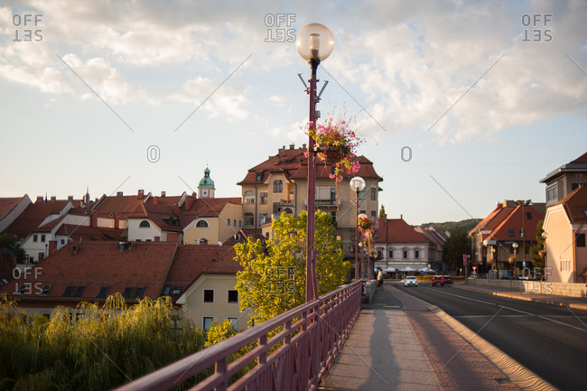 The Old Bridge with lamppost and pink flowers in Maribor, Slovenia