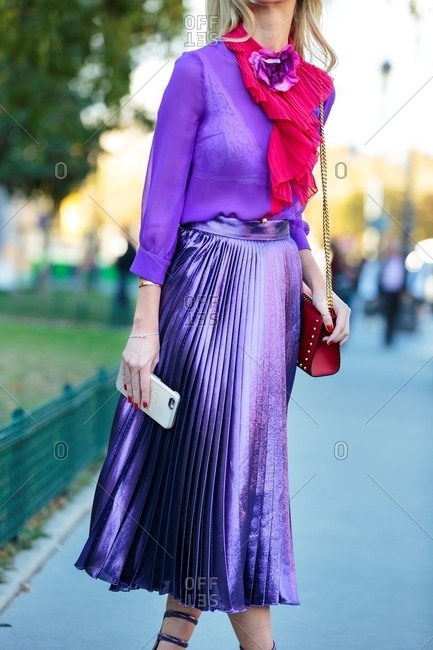 March 14, 2017: Woman in pleated purple skirt and sheer blouse