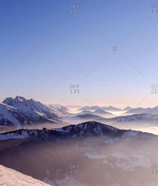 Mountain landscape with snow at sunrise