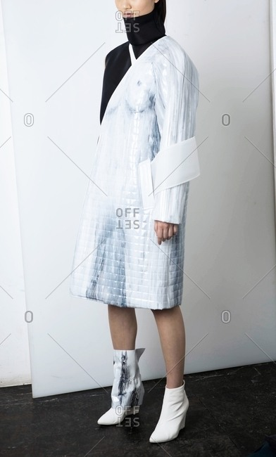 March 14, 2017: Woman in quilted white coat with white booties